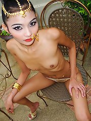 Skinny Thai girl Eaw stripping outdoors to show off her slender body